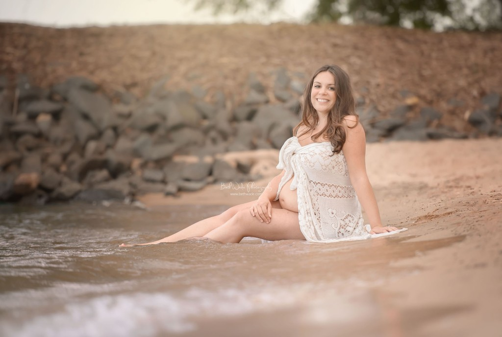 smiling  pregnant  mama sitting by water {charlotte maternity photography}