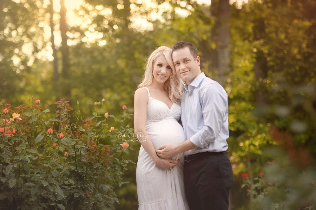 couple in garden at sunset expecting twin baby girls {charlotte maternity photography}