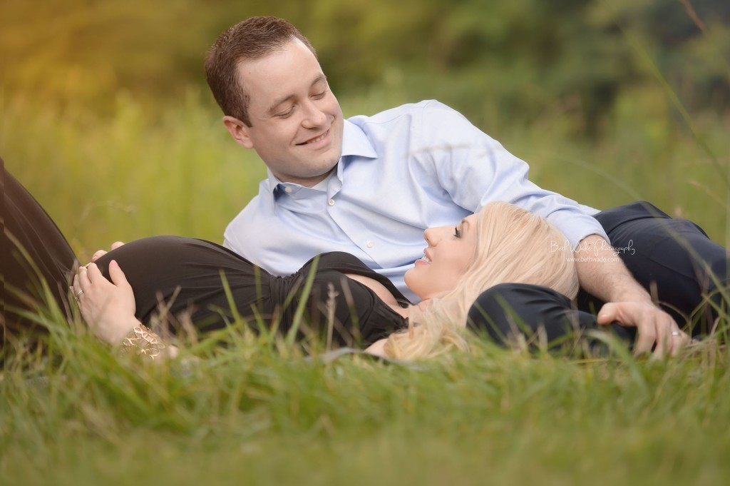 sophisticated couple - laying down in the grass expecting twin baby girls {charlotte maternity photography}